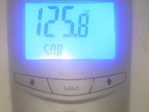 125.8 lb/ 57 kg